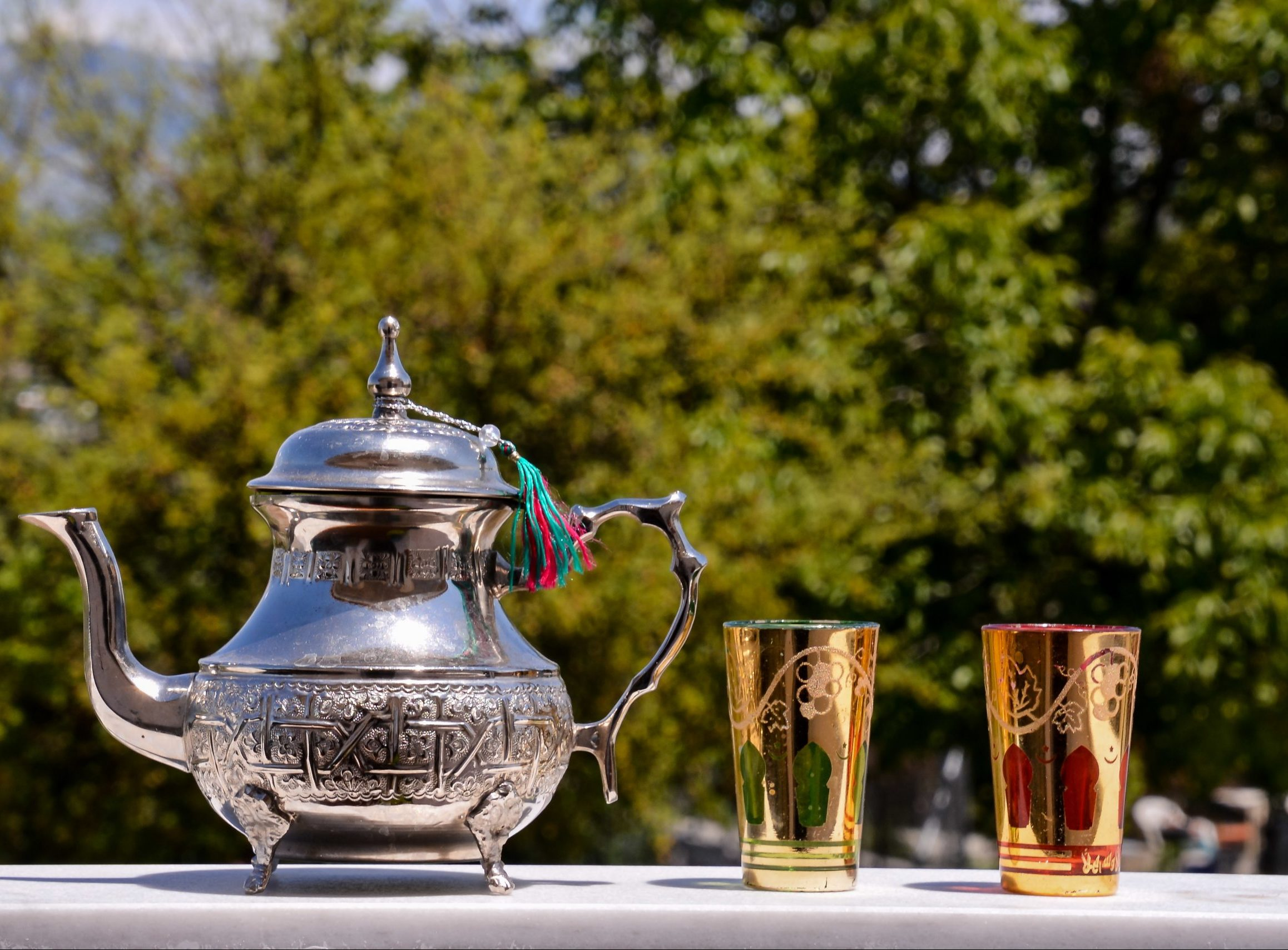 elegant silver teapot with golden glasses scaled